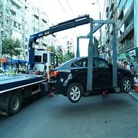 Utile - Judecatorii au hotarat ca ridicarea masinilor parcate neregulamentar este ilegala