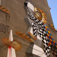 Locuri de vizitat - Graffitiul din Bucuresti al supereroului Romanism, de Allan Dalla